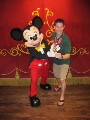 Preston celebrating his accomplishment with Mickey Mouse