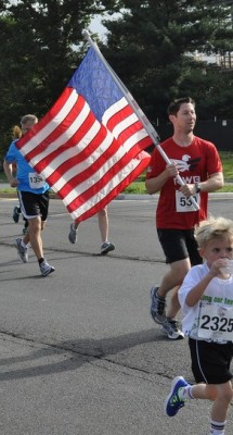 Preston carrying the flag along Reston Parkway during the first half of the race