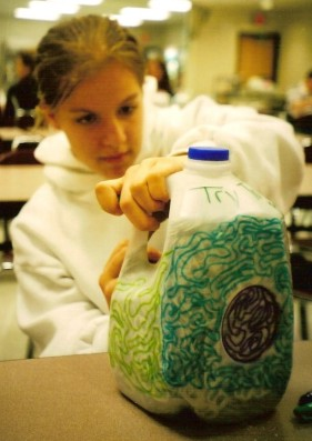 My friend BreAnne decorating one of the many milk jugs that were taken to Memphis in Tammy's honor