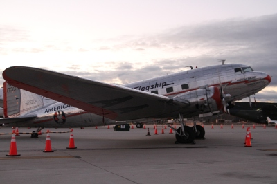 An older American Airlines plane, just off to the side of the start and finish line of the race