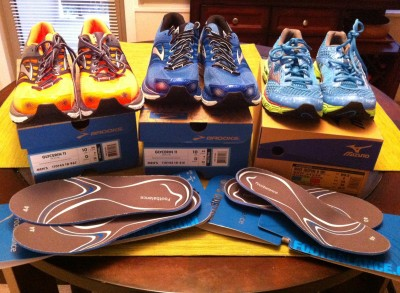 Our post shoe fitting purchases: two pairs of Brooks Glycerin for Preston, a pair of Mizuno Wave Runner for me, and a pair of molded insoles for each of us