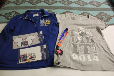 "My official race merchandise - jacket, ""I Did It"" shirt (which we later found in the Jostens Center), magnets, and Sweaty Bands headband"