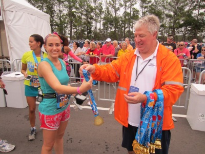 One of the many amazing volunteers I encountered during my first half marathon