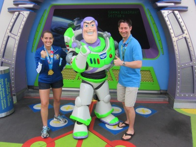 Showing off with Buzz Lightyear just how strong and powerful we felt after I completed my first half marathon and Preston completed the inaugural Dopey Challenge