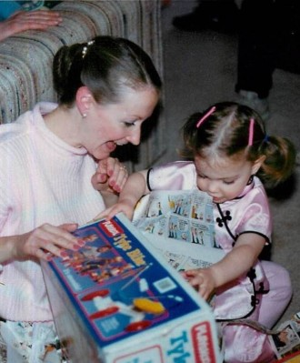 My mom and I opening birthday presents when I was younger