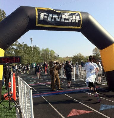 After crossing the finish line runners got a high five from the FCHS mascot, the Jaguar
