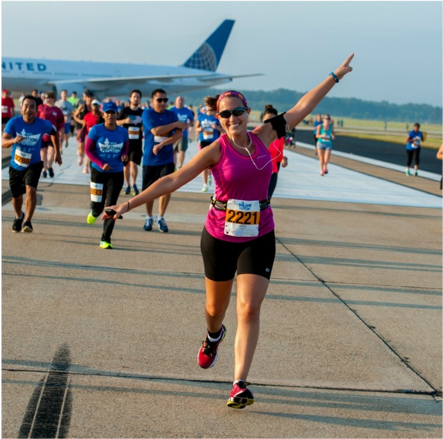 Running on the runway at Dulles Airport during the Dulles Day 10k in September 2014 Photo Credit: PR Races