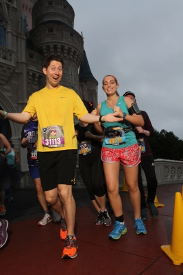 Preston and I right after we ran through Cinderella's Castle in January 2014 during the Disney World Half Marathon Photo Credit: MarathonFoto