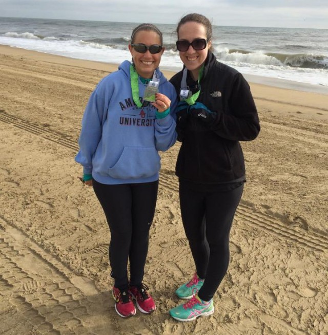Kathleen and I celebrating our 8k finish on the beach