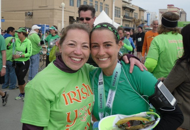 Celebrating with Christine at the finish line of the Shamrock Half Marathon last March