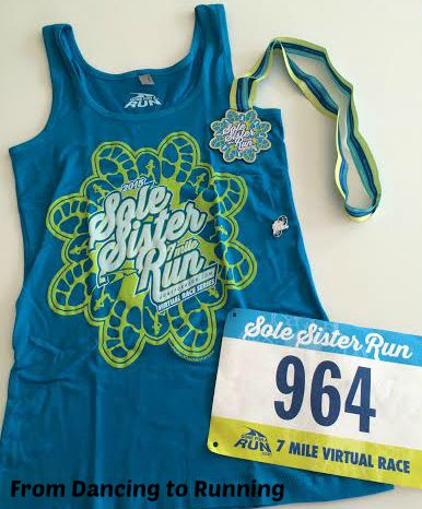 The swag for this race included a women's tank top, bib, shoe charm, and medal