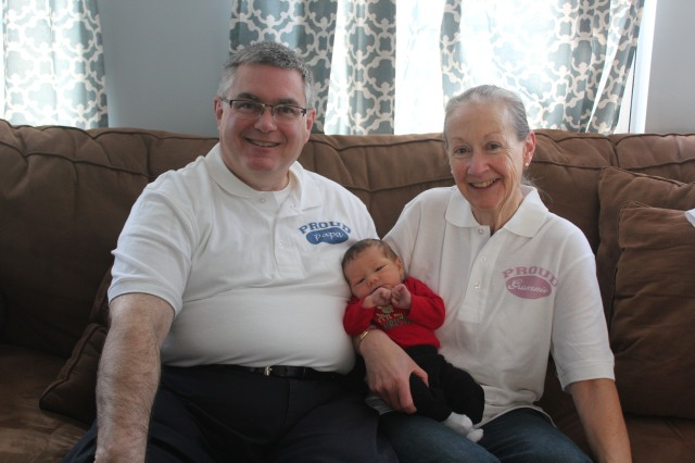 My parents with little man back on New Year's Eve, when little man was just eight days old