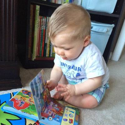 Little man reading some of his books earlier this week
