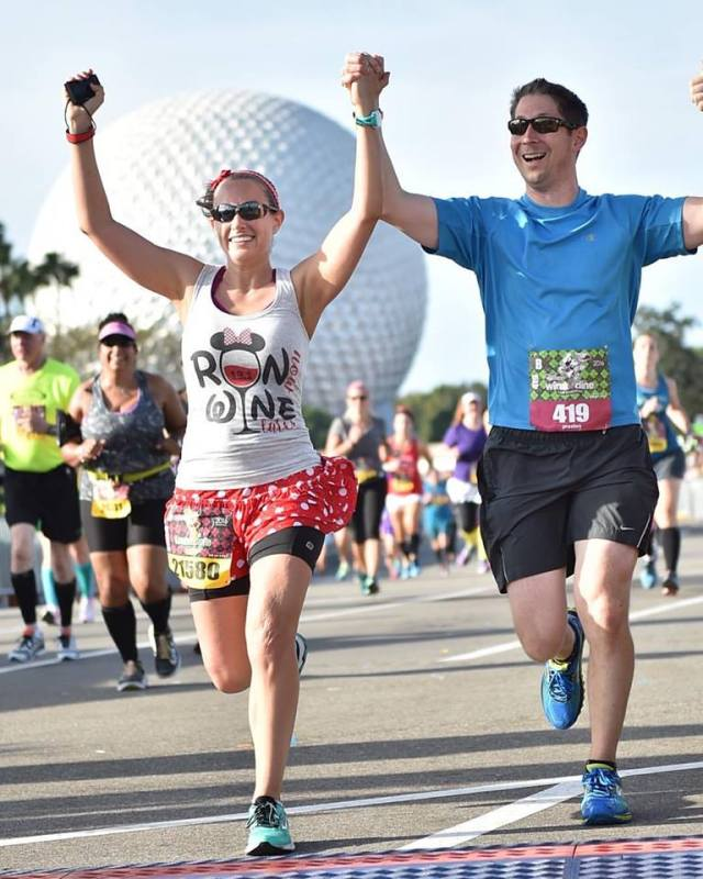 My husband and I crossing the finish line of Wine and Dine Half Marathon in November 2016 Photo Credit: Disney World PhotoPass