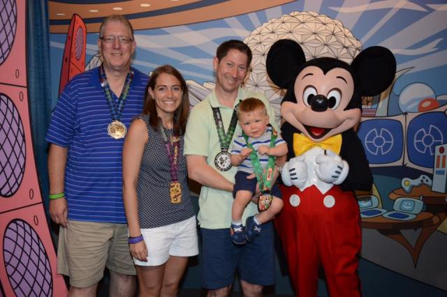 Showing off our medals with Mickey on Monday