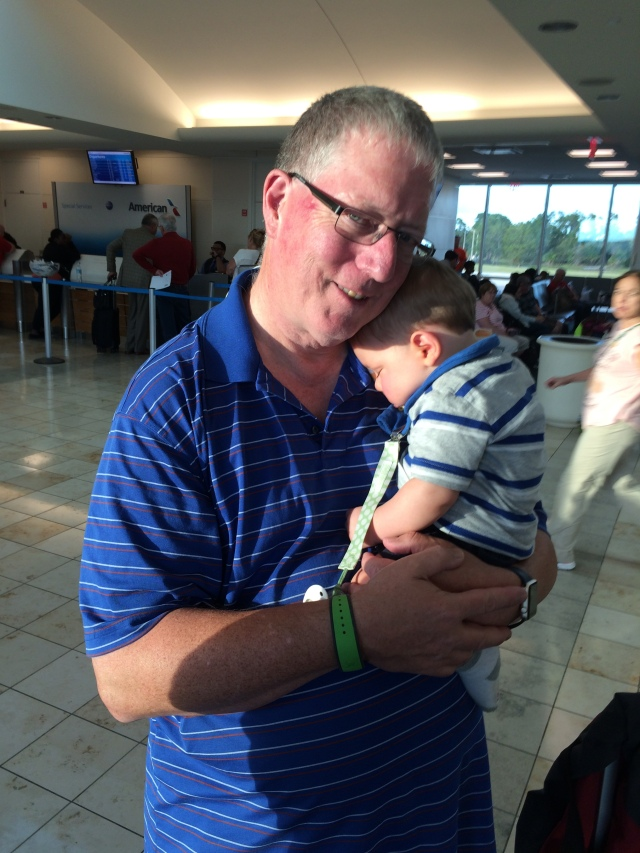Grandpop and a tired little man during our flight delay